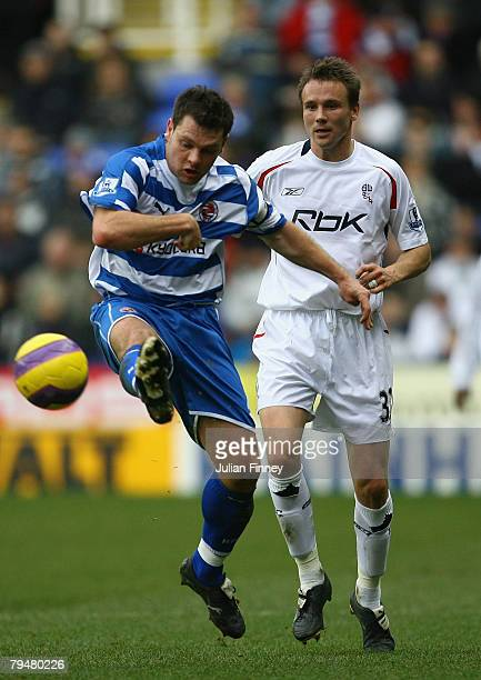 Graeme Murty of Reading battles with Matt Taylor of Bolton during the Barclays Premier League match between Reading and Bolton at the Madejski...