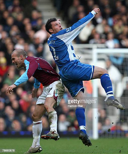 Graeme Murty of Reading falls into Freddie Ljungberg of West Ham as he attempts to head the ball during the Barclays Premier League match between...