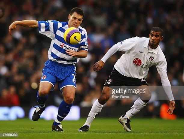 Graeme Murty of Reading holds off the challenge of Hameur Bouazza of Fulham during the Barclays Premier League match between Fulham and Reading at...