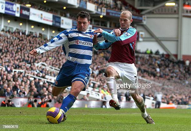 Graeme Murty of Reading is closed down by Freddie Ljungberg of West Ham as he attempts to cross the ball during the Barclays Premier League match...