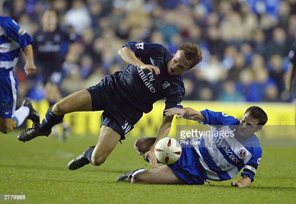 Graeme Murty of Reading tackles Jesper Gronkjaer of Chelsea during the Carling Cup fourth round match between Reading and Chelsea at The Madejski...