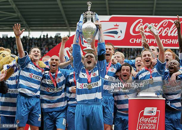 Graeme Murty the Reading captain lifts the trophy as he celebrates with his team mates after winning the Championship league with a record points...