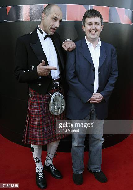 Graeme Obree and director Douglas MacKinnon pose as they arrive at the opening of The Flying Scotsman film premier at the Edinburgh International...