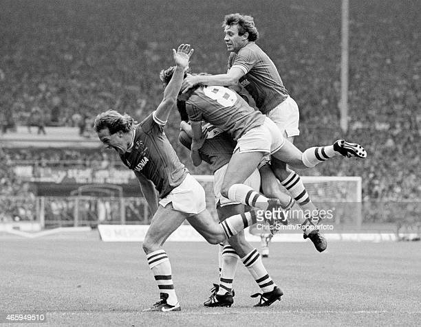 Graeme Sharp is mobbed by Andy Gray Adrian Heath and Peter Reid after scoring Everton's first goal during the FA Cup Final between Everton and...
