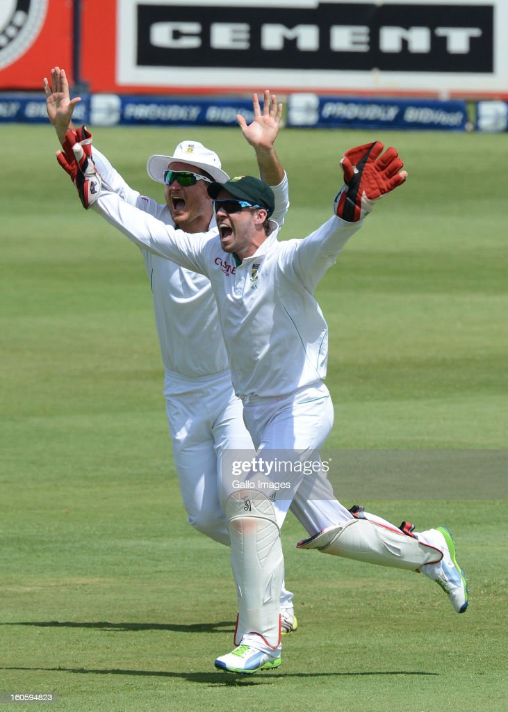Graeme Smith and AB de Villiers of South Africa claim another wicket during day 3 of the 1st Test match between South Africa and Pakistan at Bidvest Wanderers Stadium on February 03, 2013 in Johannesburg, South Africa.