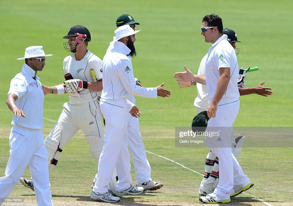 Graeme Smith and South Africa players celebrates the series win during day 4 of the 2nd Test match between South Africa and New Zealand at Axxess St Georges on January 14, 2013 in Port Elizabeth, South Africa.