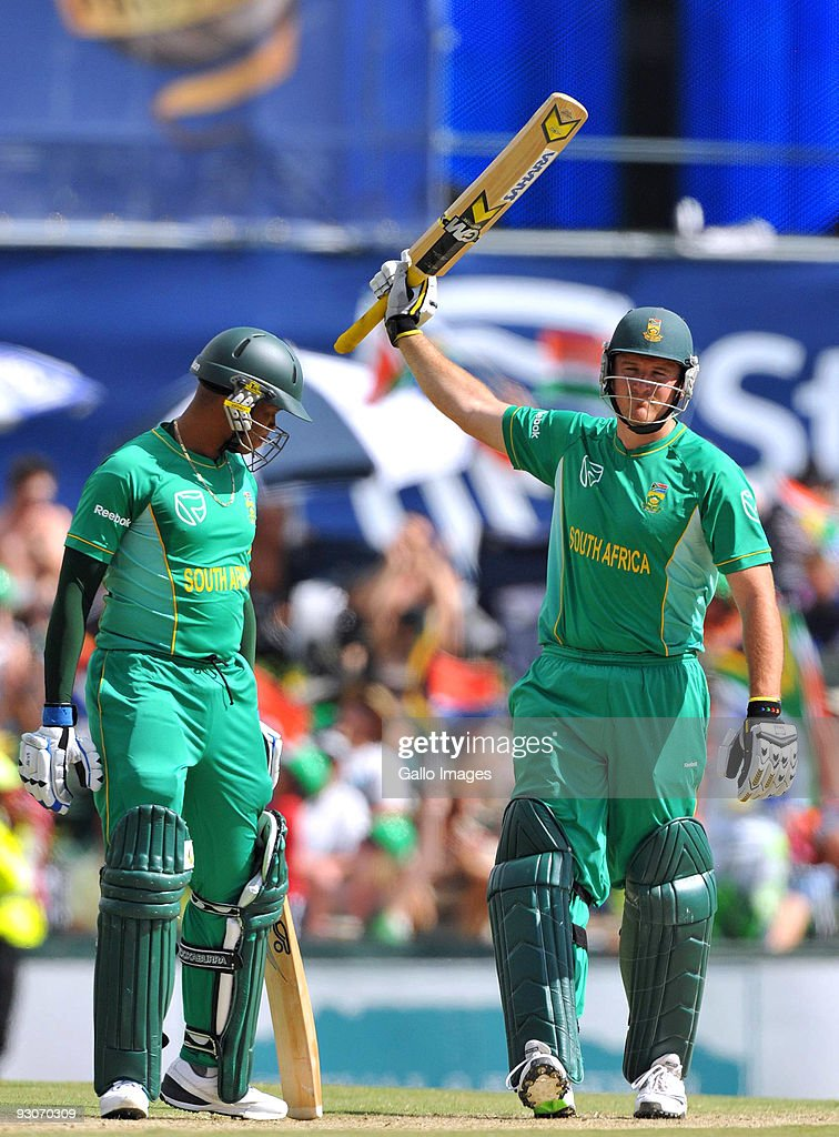 Graeme Smith captain of South Africa celebrates reaching his 50 with team mate Loots Bosman during the 2nd Twenty20 international match between South Africa and England at SuperSport Park Stadium on November 15, 2009 in Centurion, South Africa.