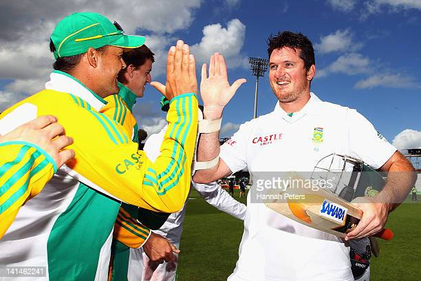 Graeme Smith celebrates with Jacques Rudolph of South Africa after winning the Second Test match on day three between New Zealand and South Africa at...