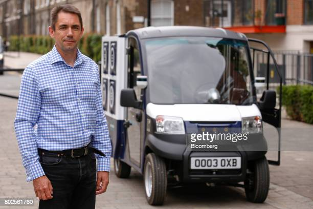 Graeme Smith chief executive officer of Oxbotica Ltd poses for a photograph during a demonstration of the CargoPod autonomous grocery delivery...