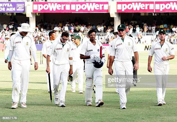 Graeme Smith leads his team off with Rahul Dravid during day three of the Third Test match between India and South Africa at Green Park Stadium on...