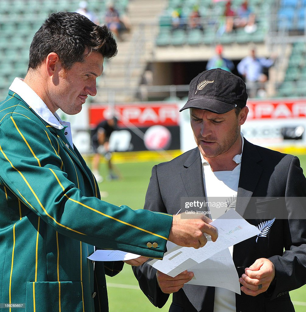 Graeme Smith of South Africa and Brendon McCullum of New Zealand exchanges team sheets at the toss during day one of the second test match between South Africa and New Zealand at Axxess St Georges on January 11, 2013 in Port Elizabeth, South Africa.