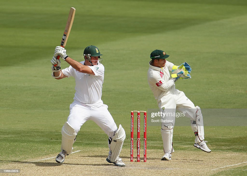 Graeme Smith of South Africa hits a boundary as <a gi-track='captionPersonalityLinkClicked' href=/galleries/search?phrase=Matthew+Wade&family=editorial&specificpeople=724041 ng-click='$event.stopPropagation()'>Matthew Wade</a> of Australia looks on during day two of the Second Test match between Australia and South Africa at Adelaide Oval on November 23, 2012 in Adelaide, Australia.