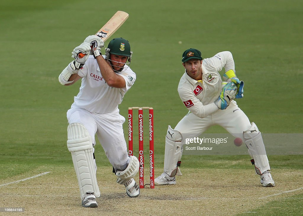 Graeme Smith of South Africa hits a boundary as Matthew Wade of Australia looks on during day two of the Second Test match between Australia and South Africa at Adelaide Oval on November 23, 2012 in Adelaide, Australia.