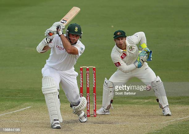 Graeme Smith of South Africa hits a boundary as Matthew Wade of Australia looks on during day two of the Second Test match between Australia and...
