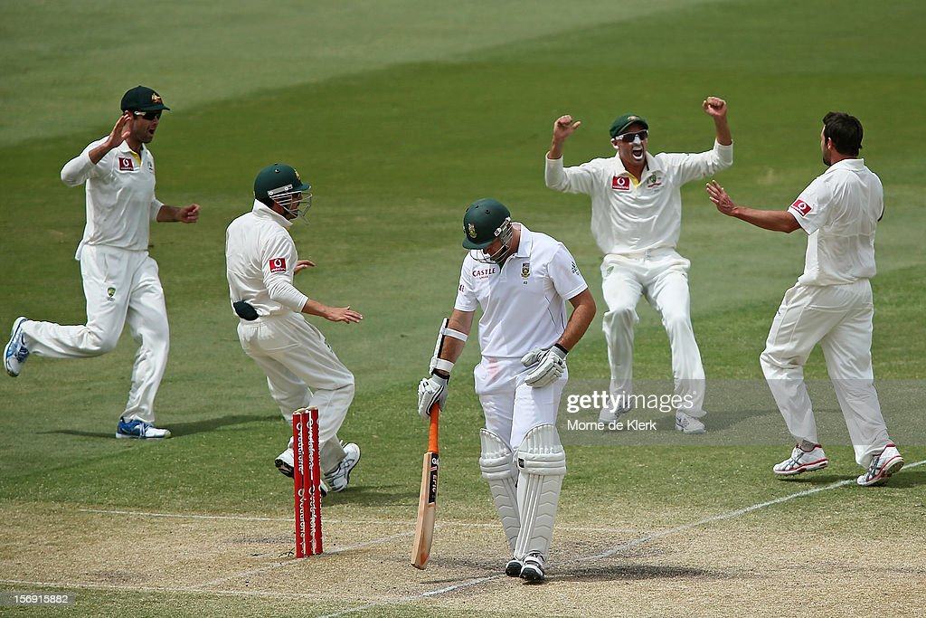 Graeme Smith of South Africa leaves the field after getting out as Australian players celebrate during day four of the Second Test Match between Australia and South Africa at Adelaide Oval on November 25, 2012 in Adelaide, Australia.