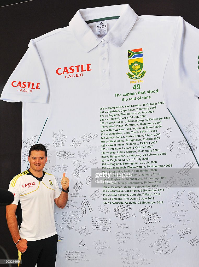Graeme Smith of South Africa poses next to a sign displaying messages of congratulations from fans ahead of Graeme Smith's 100th Test as captain at Sandton City on January 29, 2013 in Johannesburg, South Africa.