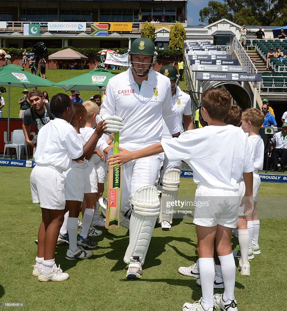 <a gi-track='captionPersonalityLinkClicked' href=/galleries/search?phrase=Graeme+Smith+-+Cricket+Player&family=editorial&specificpeople=193816 ng-click='$event.stopPropagation()'>Graeme Smith</a> of South Africa walks onto the feild during his 100th test as captain during day 1 of the first Test match between South Africa and Pakistan at Bidvest Wanderers Stadium on February 01, 2013 in Johannesburg, South Africa.