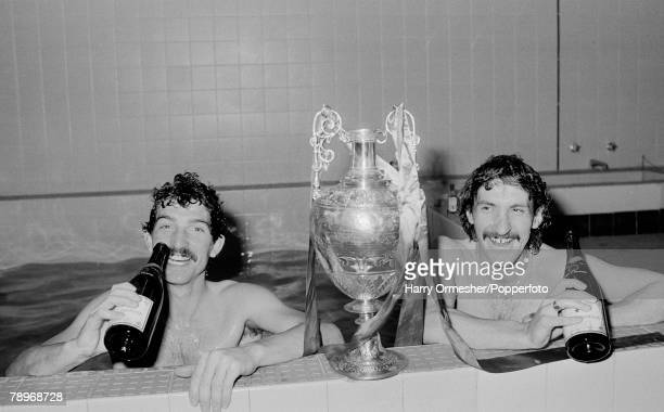 Football 3rd May 1980 Anfield Liverpool Liverpool 4 v Aston Villa 1 Liverpools Graeme Souness and Terry McDermott toast their success while relaxing...
