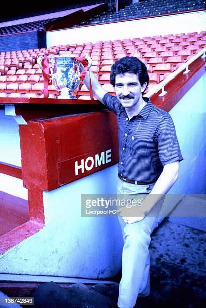 Graeme Souness captain of Liverpool FC poses with the actual League Cup by the side of the dug out following the League Cup final victory against...
