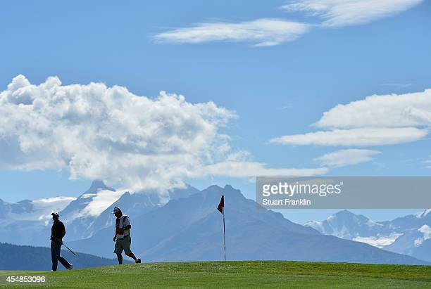 Graeme Storm of England and caddie in action during the final round of the Omega European Masters at CranssurSierre Golf Club on September 7 2014 in...
