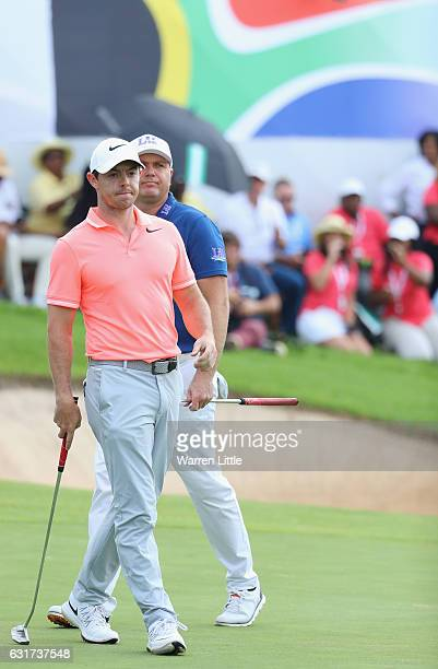 Graeme Storm of England and Rory McIlroy of Northern Ireland look on from the18th green during the final round of the BMW South African Open...