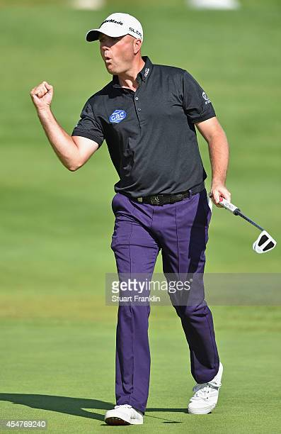 Graeme Storm of England celebrates holeing a putt on the 17th hole during the third round of the Omega European Masters at CranssurSierre Golf Club...