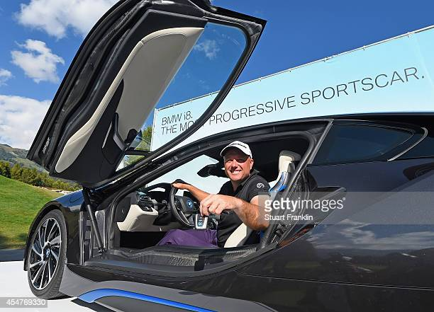 Graeme Storm of England holds the key to a BMW i8 car that he won after making a hole in one on the 11th hole during the third round of the Omega...