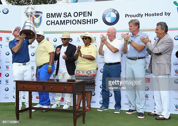 Graeme Storm of England lifts the trophy after winning the BMW South African Open Championship at Glendower Golf Club on January 15 2017 in...