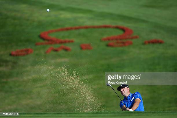 Graeme Storm of England plays his second shot from a bunker on the seventh hole during the second round of the Omega European Masters at...