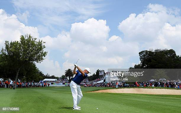Graeme Storm of England plays his second shot into the 18th green during the final round of the BMW South African Open Championship at Glendower Golf...