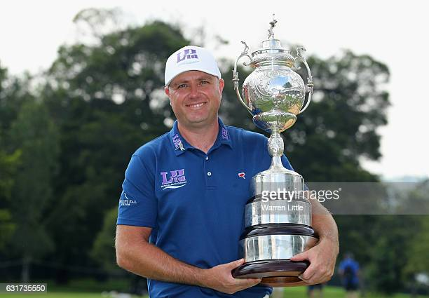 Graeme Storm of England poses with the trophy after winning the BMW South African Open Championship at Glendower Golf Club on January 15 2017 in...