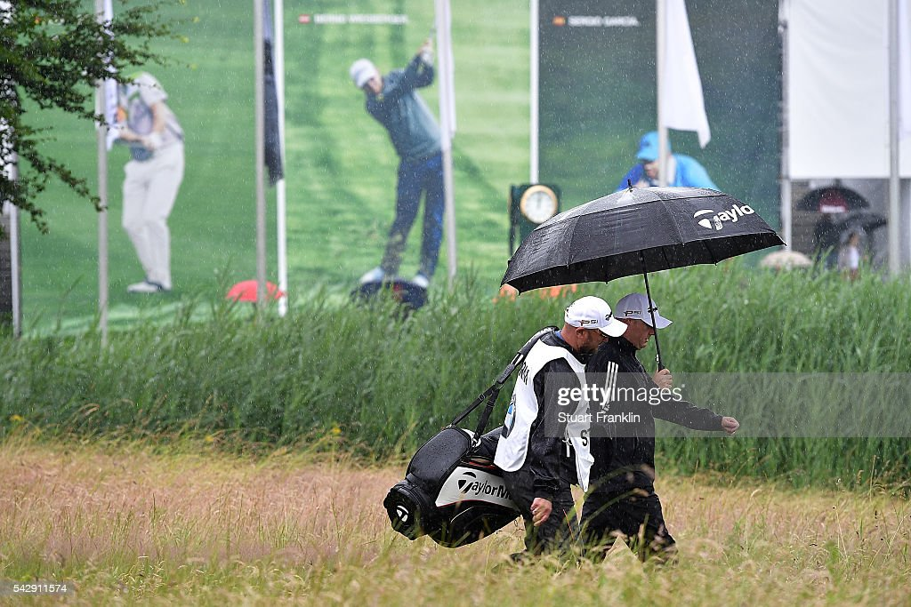 <a gi-track='captionPersonalityLinkClicked' href=/galleries/search?phrase=Graeme+Storm&family=editorial&specificpeople=238970 ng-click='$event.stopPropagation()'>Graeme Storm</a> of England walks in the rain with his caddie during the third round of the BMW International Open at Gut Larchenhof on June 25, 2016 in Cologne, Germany.