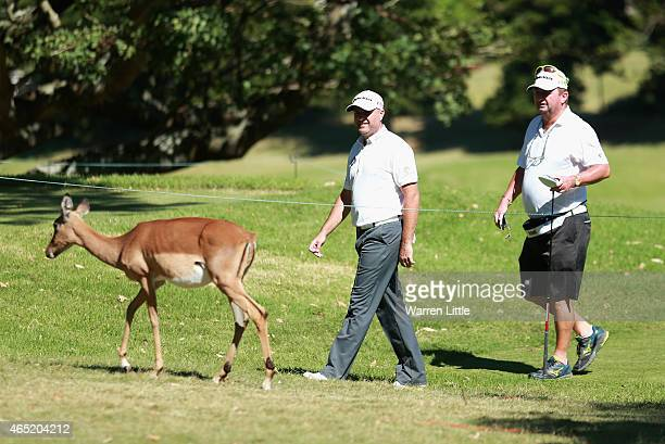 Graeme Storm of England watches a buck with his caddie during a practice round ahead of the Africa Open at East London Golf Club on March 4 2015 in...