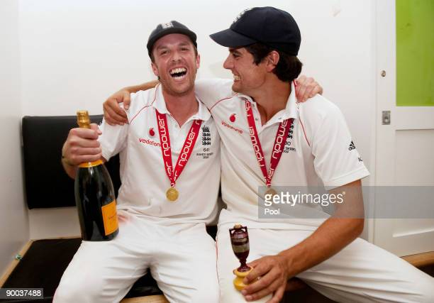 Graeme Swann and Alastair Cook of England celebrate with the Ashes Urn in the changing room following the fifth npower Test Match at the Oval on...