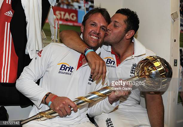 Graeme Swann and Tim Bresnan of England celebrate the series victory with the ICC Test Championship Mace in the dressing room as England become the...