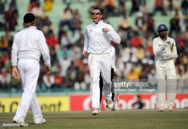 Graeme Swann celebrates with Ian Bell after Bell caught Gautam Gambhir off Swann's bowling for 97 during the fifth day of the second test at the...