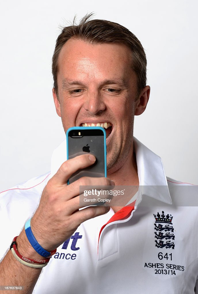 Graeme Swann films on his cameraphone during an England cricket headshots session at the InterContinental Sydney on November 11, 2013 in Sydney, Australia.