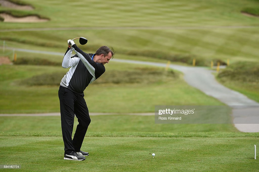 <a gi-track='captionPersonalityLinkClicked' href=/galleries/search?phrase=Graeme+Swann&family=editorial&specificpeople=578767 ng-click='$event.stopPropagation()'>Graeme Swann</a> hits a shot during the Pro-Am prior to the BMW PGA Championship at Wentworth on May 25, 2016 in Virginia Water, England.