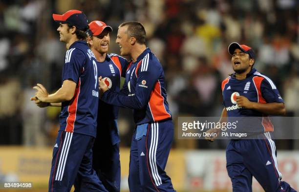 Graeme Swann is congratulated after taking the wicket of Virender Sehwag during the Fourth One Day International at M Chinnaswamy Stadium Bangalore...