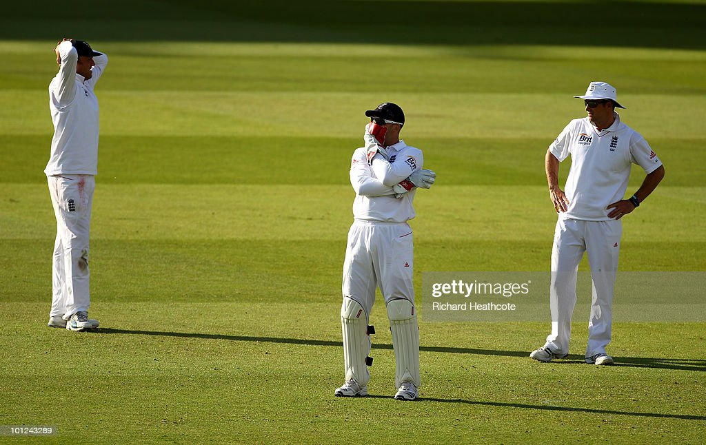 Graeme Swann, Matt Prior and Captain Andrew Strauss of England look dejected as a ball makes it's way through to the boundary during day two of the 1st npower Test between England and Bangladesh at Lords on May 28, 2010 in London, England.