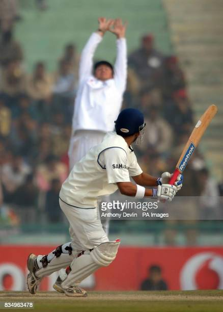 Graeme Swann misses a catch from Gautam Gambhir during the fifth day of the second test at the Punjab Cricket Association Stadium Mohali India