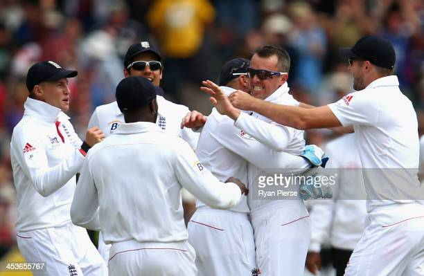 Graeme Swann of England celebrates after taking the wicket of Chris Rogers of Australia during day one of the Second Ashes Test Match between...