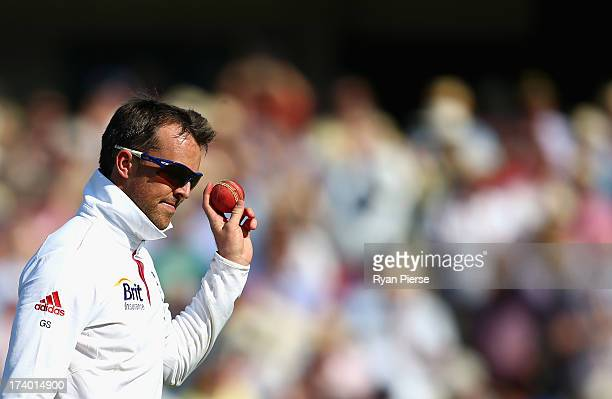 Graeme Swann of England celebrates after talking his fifth wicket during day two of the 2nd Investec Ashes Test match between England and Australia...