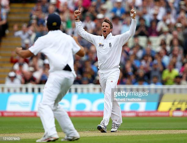 Graeme Swann of England celebrates taking the wicket of Suresh Raina of India during day four of the 3rd npower Test at Edgbaston on August 13 2011...