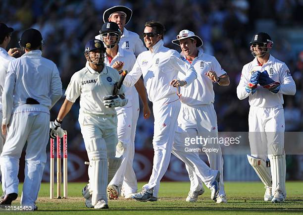 Graeme Swann of England celebrates the wicket of Sachin Tendulkar of India with team mates during day three of the 4th npower Test Match between...