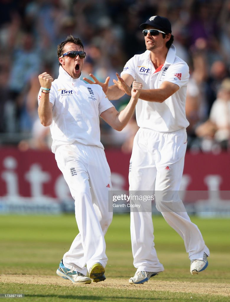 <a gi-track='captionPersonalityLinkClicked' href=/galleries/search?phrase=Graeme+Swann&family=editorial&specificpeople=578767 ng-click='$event.stopPropagation()'>Graeme Swann</a> of England celebrates the wicket of Steve Smith of Australia with <a gi-track='captionPersonalityLinkClicked' href=/galleries/search?phrase=Alastair+Cook+-+Cricket+Player&family=editorial&specificpeople=571475 ng-click='$event.stopPropagation()'>Alastair Cook</a> (R) during day four of the 1st Investec Ashes Test match between England and Australia at Trent Bridge Cricket Ground on July 13, 2013 in Nottingham, England.