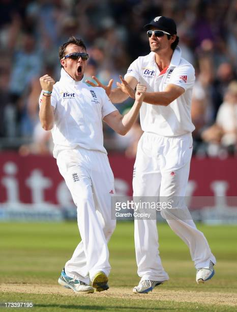 Graeme Swann of England celebrates the wicket of Steve Smith of Australia with Alastair Cook during day four of the 1st Investec Ashes Test match...