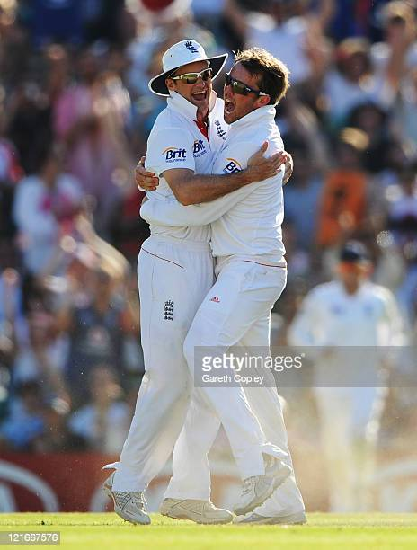 Graeme Swann of England celebrates the wicket of Virender Sehwag of India with Andrew Strauss during day four of the 4th npower Test Match between...
