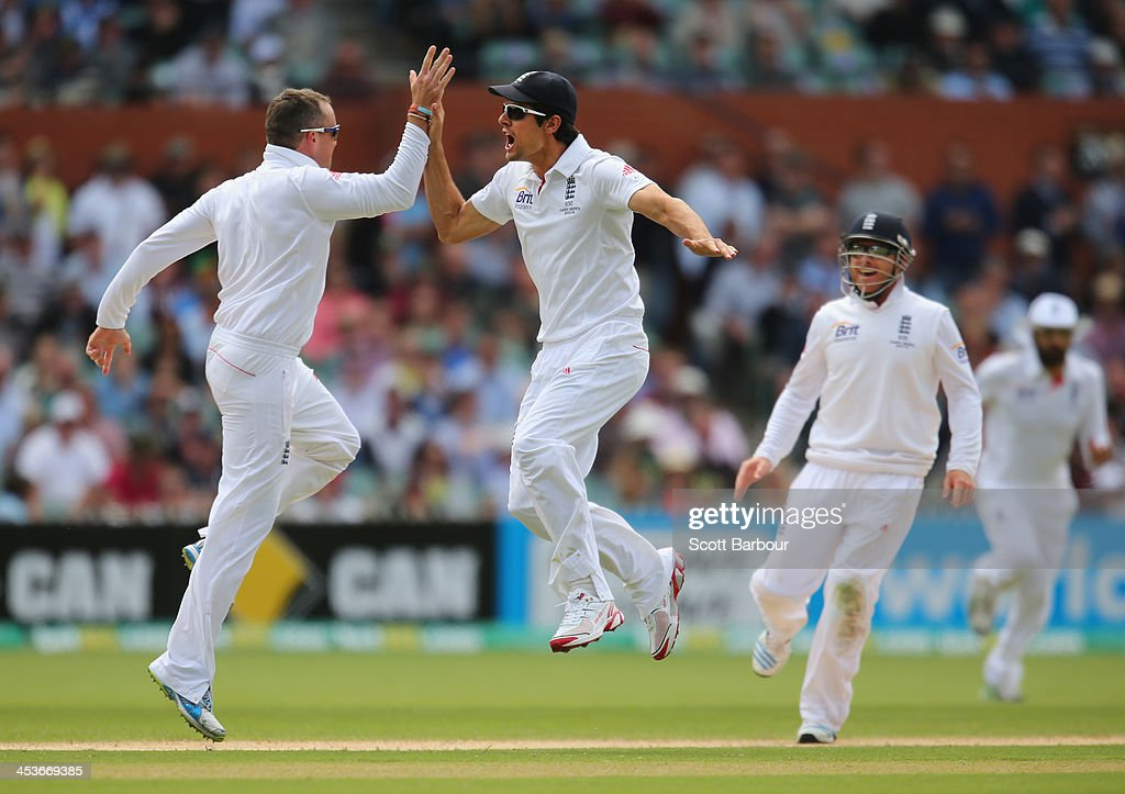 <a gi-track='captionPersonalityLinkClicked' href=/galleries/search?phrase=Graeme+Swann&family=editorial&specificpeople=578767 ng-click='$event.stopPropagation()'>Graeme Swann</a> of England celebrates with captain <a gi-track='captionPersonalityLinkClicked' href=/galleries/search?phrase=Alastair+Cook+-+Cricket+Player&family=editorial&specificpeople=571475 ng-click='$event.stopPropagation()'>Alastair Cook</a> after dismissing Chris Rogers of Australia during day one of the Second Ashes Test Match between Australia and England at Adelaide Oval on December 5, 2013 in Adelaide, Australia.
