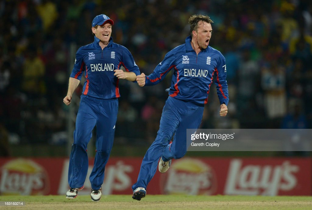 <a gi-track='captionPersonalityLinkClicked' href=/galleries/search?phrase=Graeme+Swann&family=editorial&specificpeople=578767 ng-click='$event.stopPropagation()'>Graeme Swann</a> of England celebrates with <a gi-track='captionPersonalityLinkClicked' href=/galleries/search?phrase=Eoin+Morgan&family=editorial&specificpeople=689581 ng-click='$event.stopPropagation()'>Eoin Morgan</a> after dismissing Kumar Sangakkara of Sri Lanka during the ICC World Twenty20 2012 Super Eights Group 1 match between Sri Lanka and England at Pallekele Cricket Stadium on October 1, 2012 in Kandy, Sri Lanka.